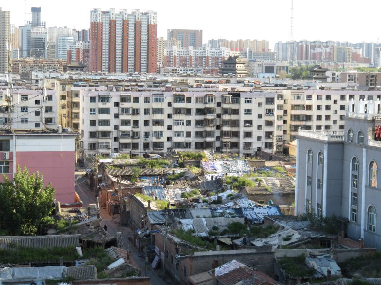 Photo: Lukas Knoflach. Various layers of urbanisation. The old city center of Datong at the forefront, Mao era apartments in the middle and new high-rise apartments in the far background.