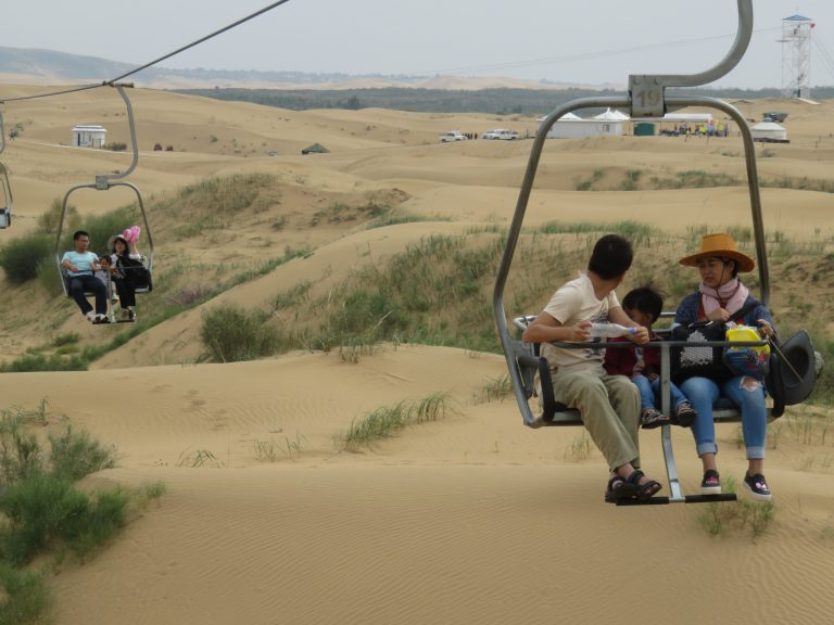 Photo: Lukas Knoflach. A repurposed ski lift in the desert carrying family No. 19 to its destination.