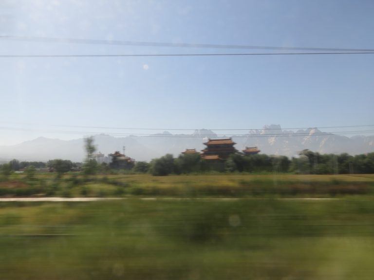 Photo: Lukas Knoflach. A landscape flying past the window, on the high-speed train from Xi'an to Beijing.